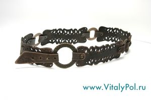 Belt with delicate perforations. On the rings. Brown.